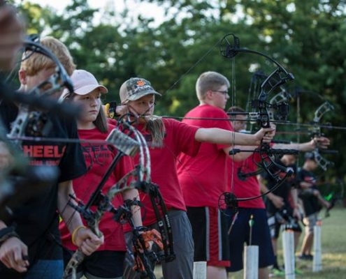 Raised-at-full-draw-archery-camp-petersons_Feature
